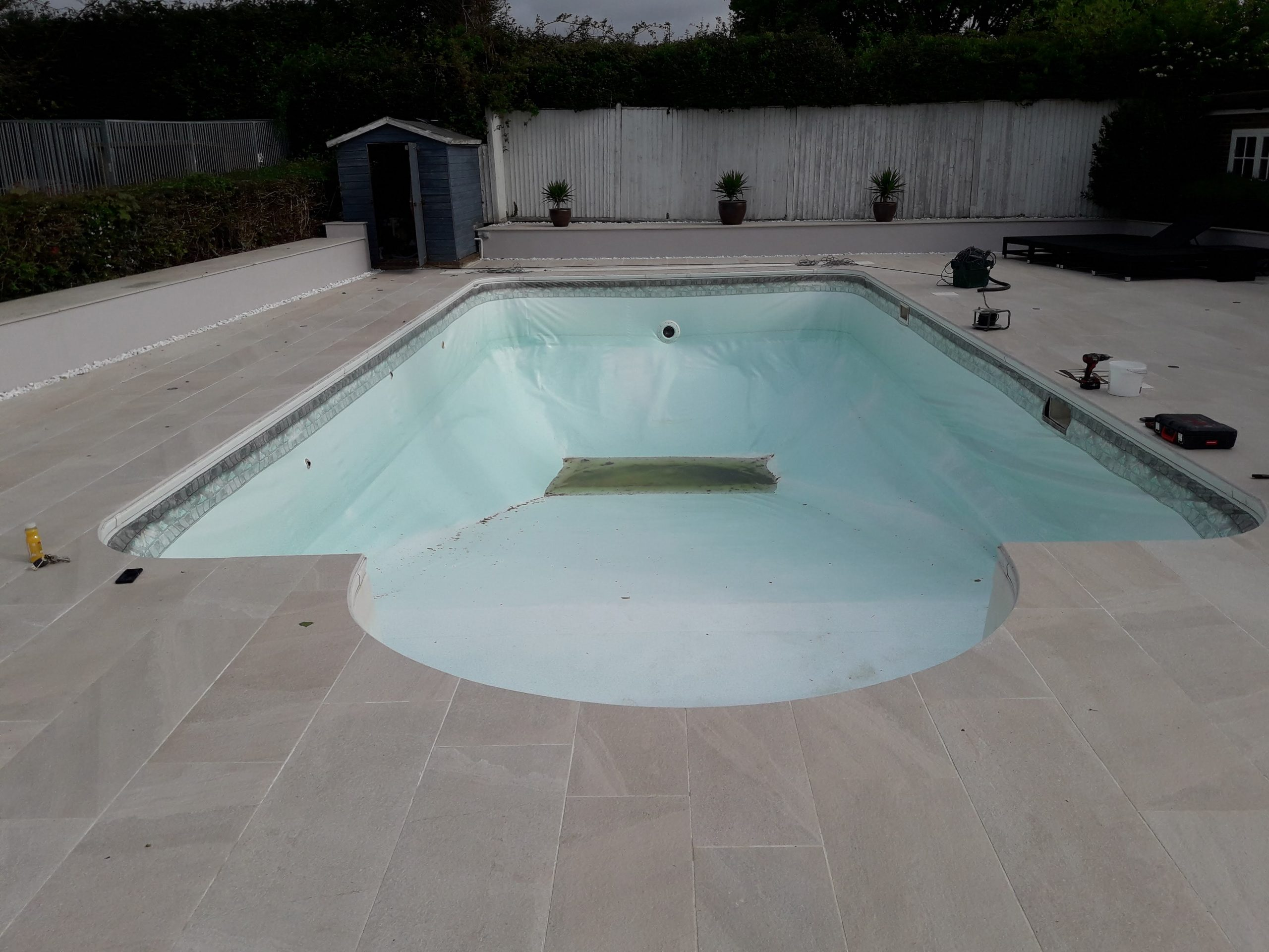 A pool that is in need of retiling and renovation