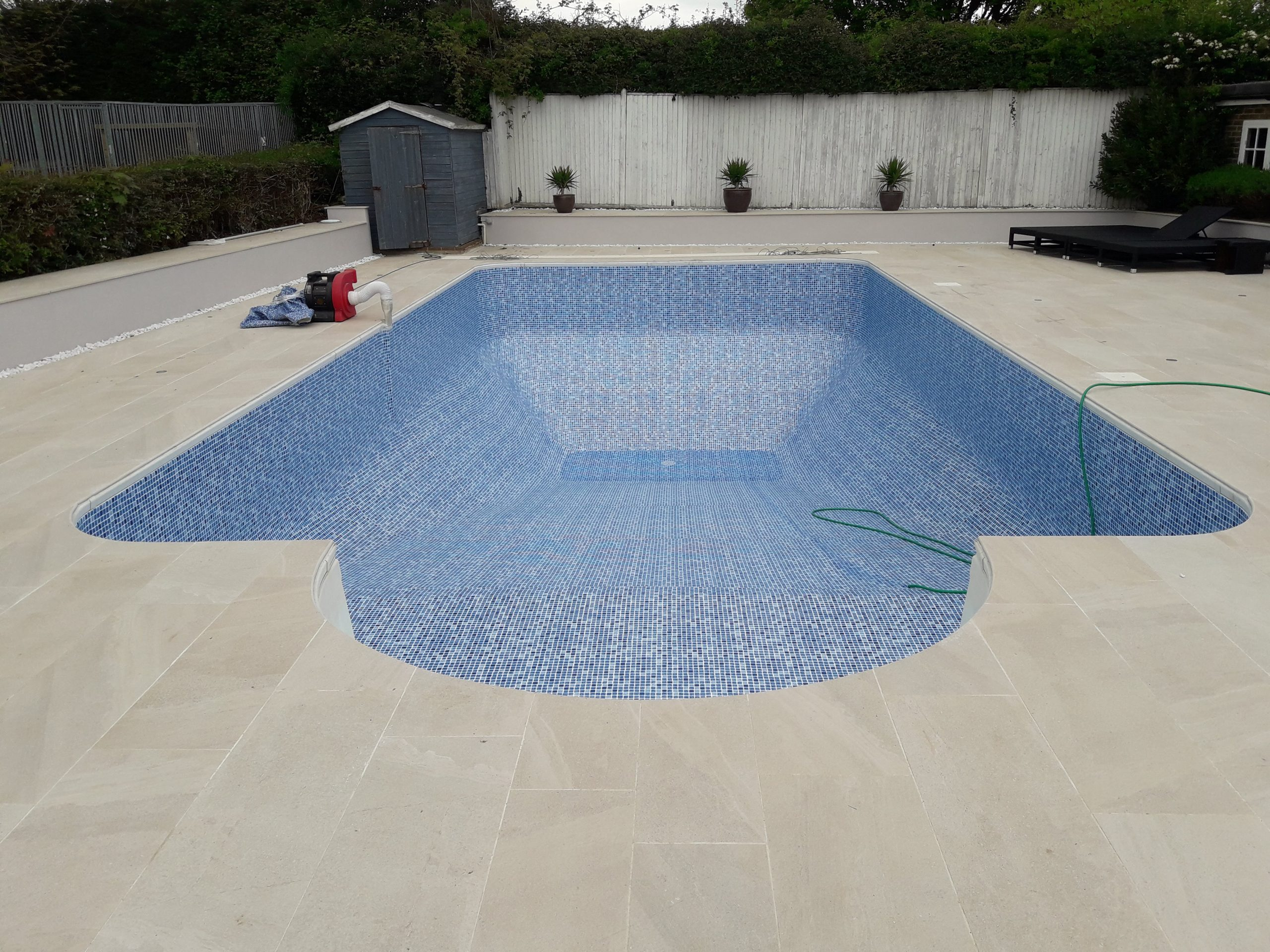 The same pool after refurbishment and new pool tiles