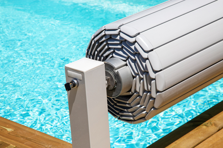 This is a slatted pool cover, wound on a roller