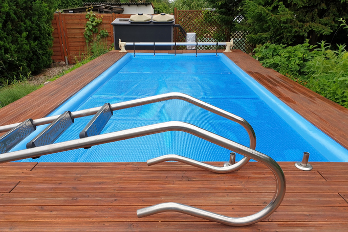 This pool is covered with a solar cover